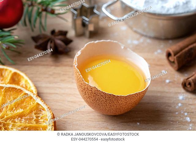 Fresh egg yolk, spices and other ingredients for Christmas baking