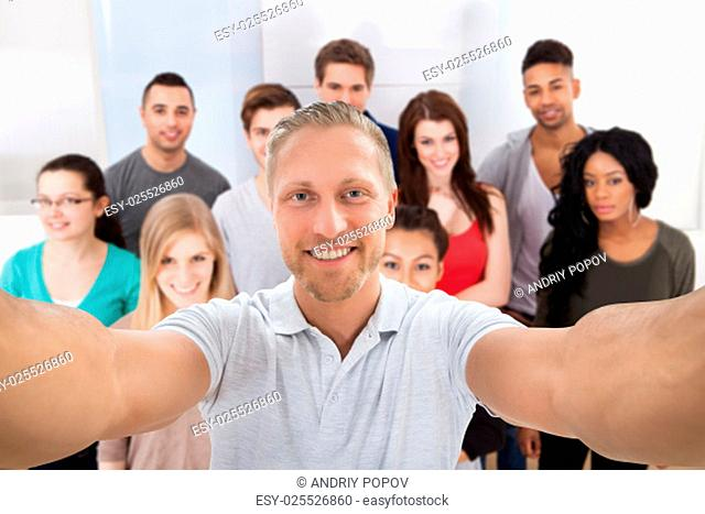 Multiracial Group Of Happy Friends Taking Selfie