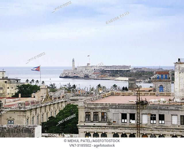 View of the lighthouse (faro) of Castillio del Morro from the old town of Havana, Cuba