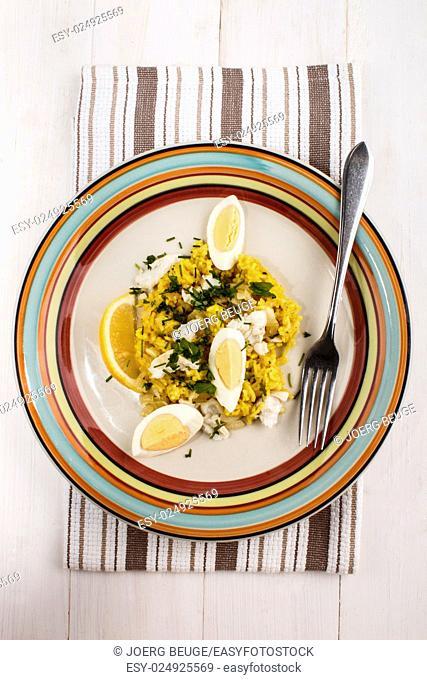 kedgeree a scottish meal with haddock, basmati rice, cardamom, egg and lemon on a plate