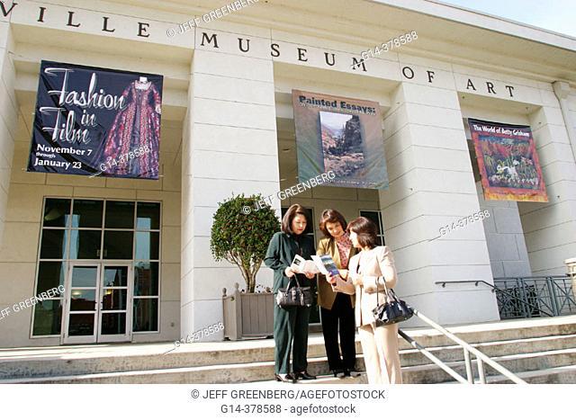 Huntsville Museum of Art, Asian female visitors read brochures. Madison County. Alabama. USA