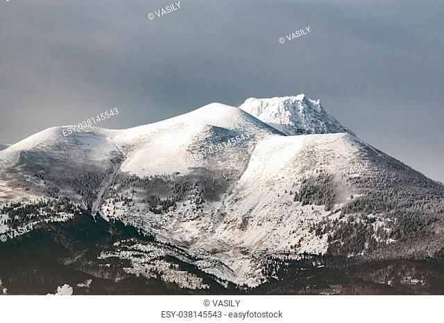 white tops of dormant volcanoes on the Kuril Islands