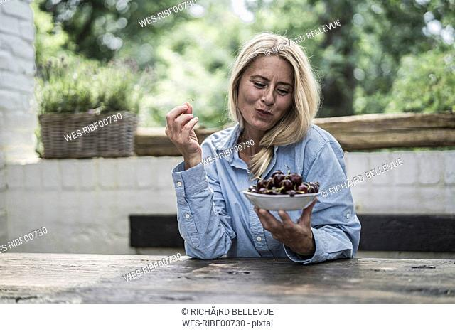Mature woman sitting on terrace