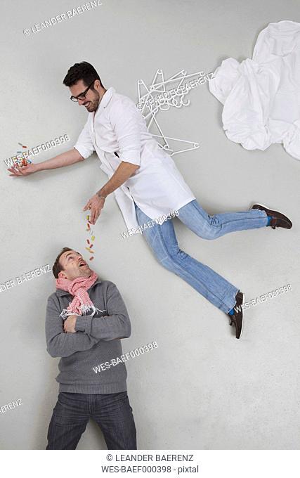 Doctor giving medicine to sick patient