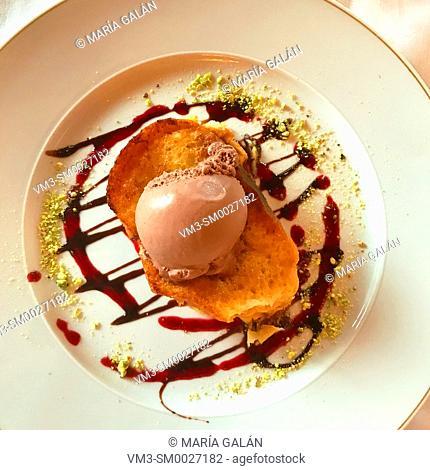 Torrija with chocolate ice cream. Spain
