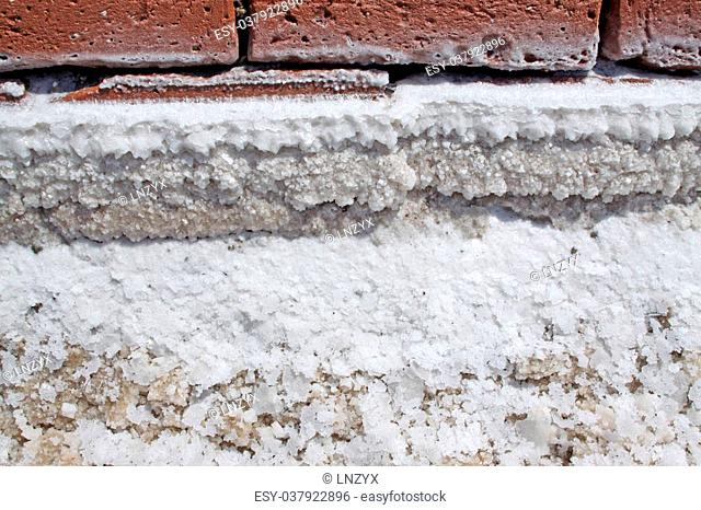 crude salt on the surface of red bricks