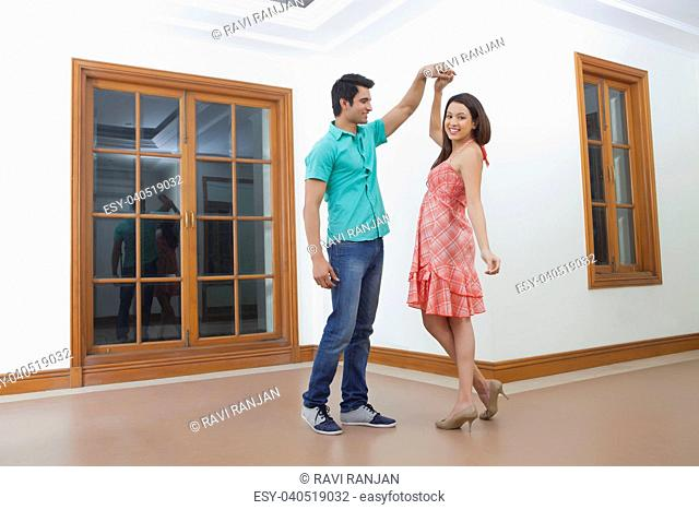 Young man and young woman dancing