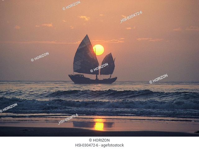 Sailboat on at sunrise near Shantou, Canton, China