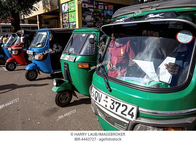 Passenger transportation, tuk-tuks waiting for passengers, Nuwara Eliya, Central Province, Sri Lanka