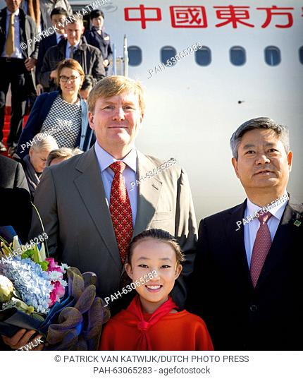 King Willem-Alexander of The Netherlands arrives at Yan-an Ershilipu Airport and are welcomed by mr Zhao Min, Foreign Affairs Office Province Shaanxi in China