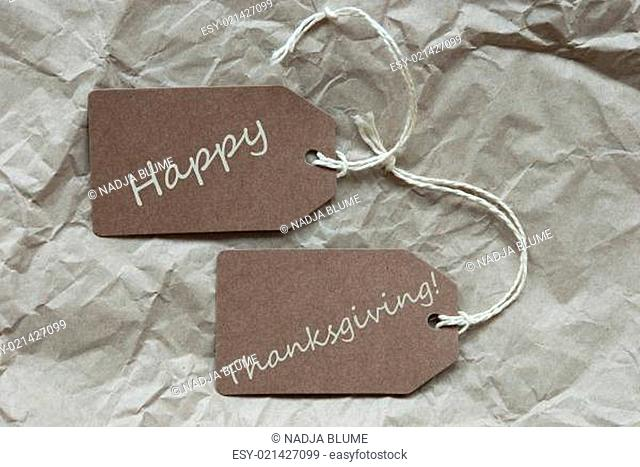 Two Brown Labels Or Tags With White Ribbon On Crumpled Paper Background With English Text Happy Thanksgiving Vintage Or Retro Style