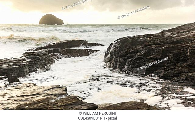 Ocean waves lapping against rocks, Trebarwith, Cornwall, UK