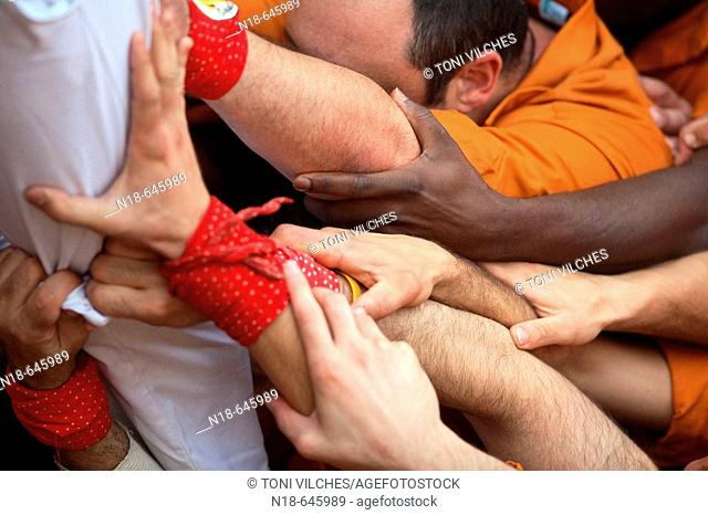 'Castellers' building human towers in Plaza Mayor. Vic. Osona. Barcelona province, Catalonia, Spain