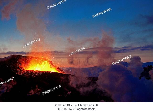 Erupting volcano between Eyjafjallajoekull and Myrdalsjoekull glaciers, Iceland, Europe