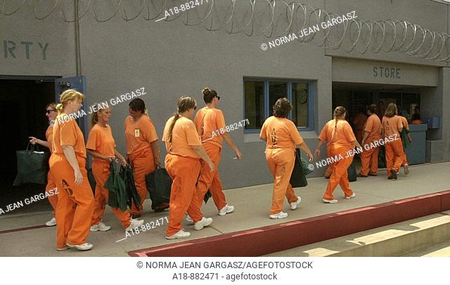 Perryville State Prison inmates at the women's prison in Goodyear, Arizona, USA, line up to make purchases at the prison store