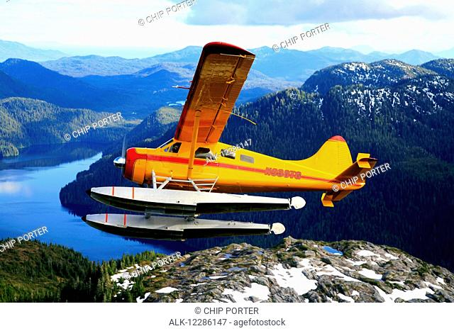 DeHavilland Beaver floatplane over the waters of Mirror Lake in the Misty Fiord National Monument Wilderness, Southeast Alaska, Summer