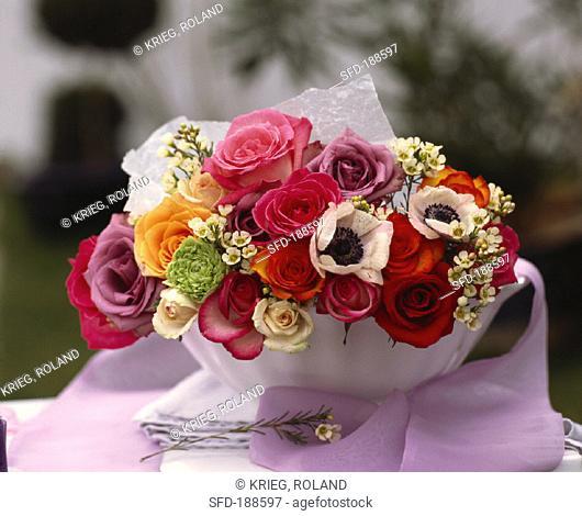 Arrangement of roses in white bowl