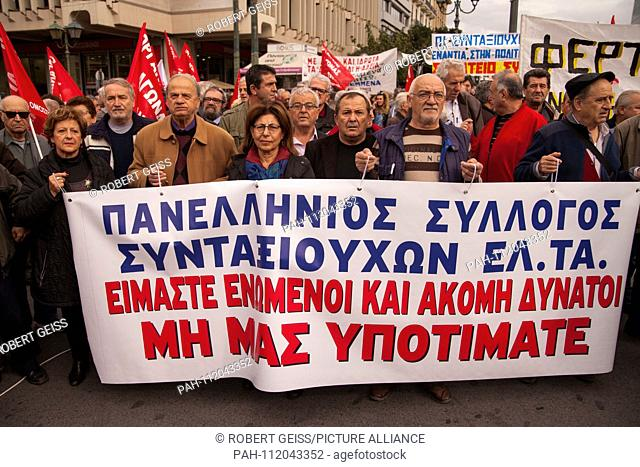 """Greek pensioners during protest against planned cut in pension payments beginning 2019. Banner """"""""We are still here. Don't underestimate us"""""""". 20.11"""