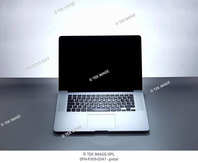 Open laptop, studio shot