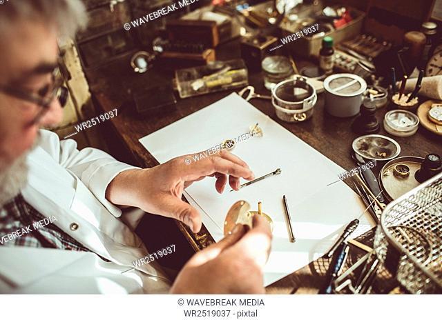 Horologist repairing a watch