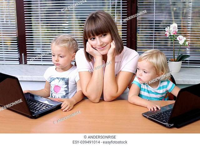 Concerned mom with two young daughters