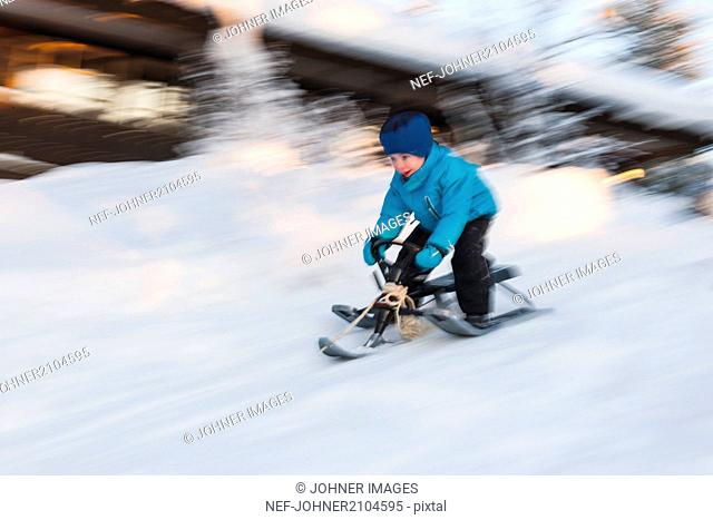 Boy on snow scooter