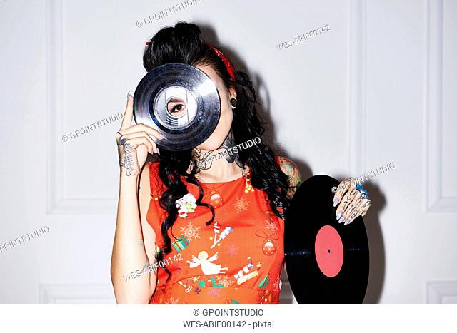 Tattooed woman with records