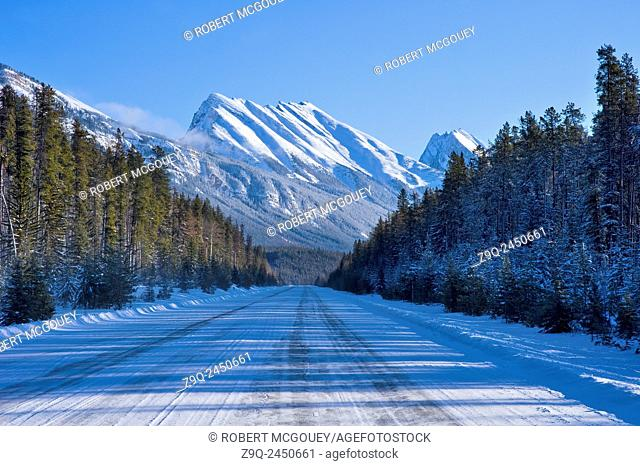 This winter image of a straight section of highway 93 leading south east from Jasper toward Calgary was captured in the Rocky mountains of Alberta on a cold...