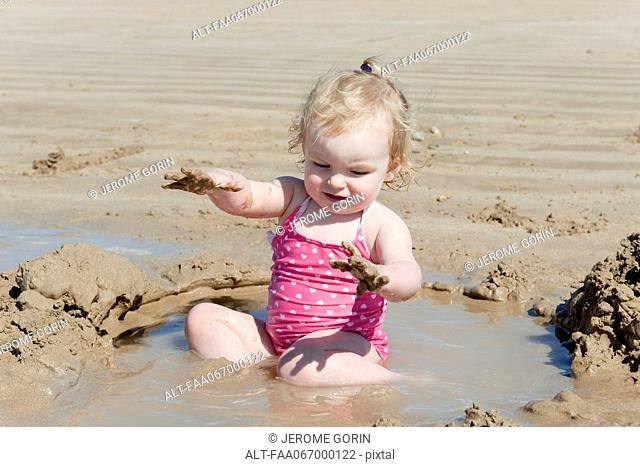 Toddler girl playing at the beach