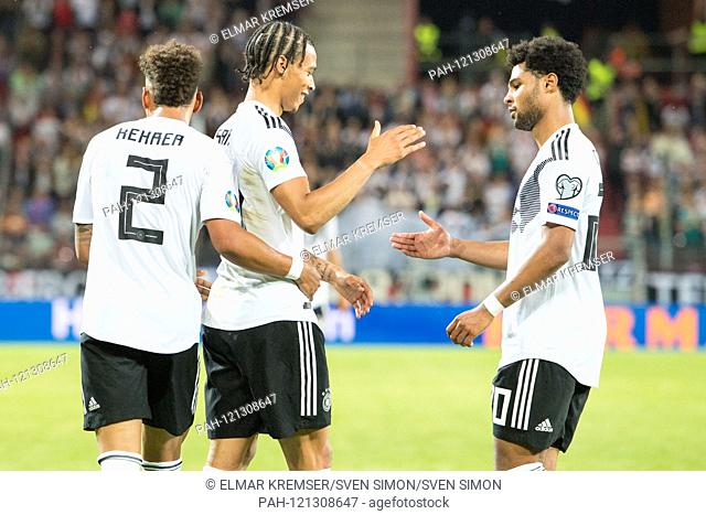 Thilo KEHRER (left, GER), Leroy SANE (mi., GER) and Serge GNABRY (GER) are happy after the end of the game, jubilation, cheering, cheering, joy, cheers