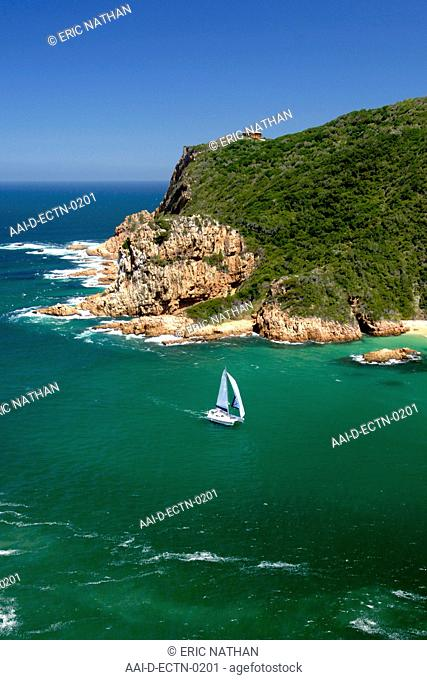 A catamaran sails through The Heads, the entrance to the Knysna lagoon on the Garden Route in South Africa