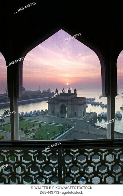 Gateway of India at dawn from Taj Mahal Hotel balcony, seen through mosquito net. Bombay. Maharashtra, India (2004)