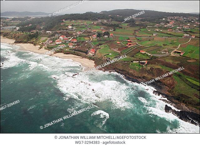 SPAIN Near Punta Faglida -- 15/12/2002 -- Aerial view of a polluted beach near Punta Faglida on the Galician coast. Thousands of volunteers and military...