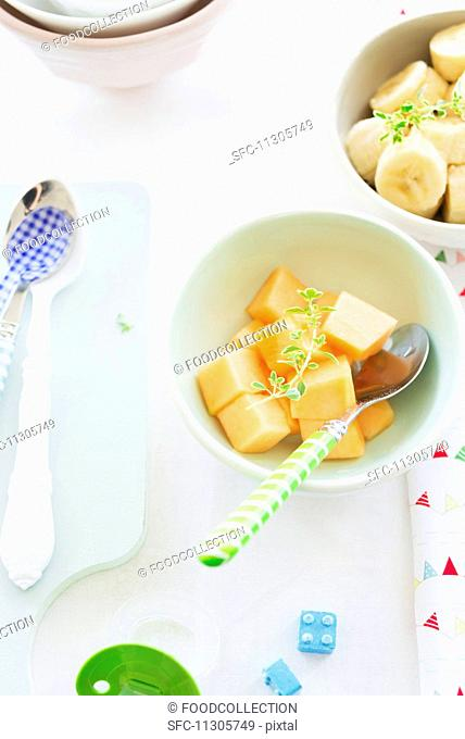 Fresh, diced melon and bananas for babies
