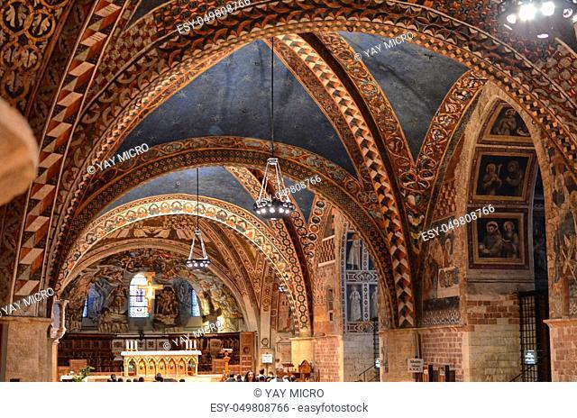 Assisi, Italy August 2016: Interior of the famous Basilica of San Francesco d'Assisi Papal Basilica of San Francesco at sunset in Assisi, Umbria, Italy