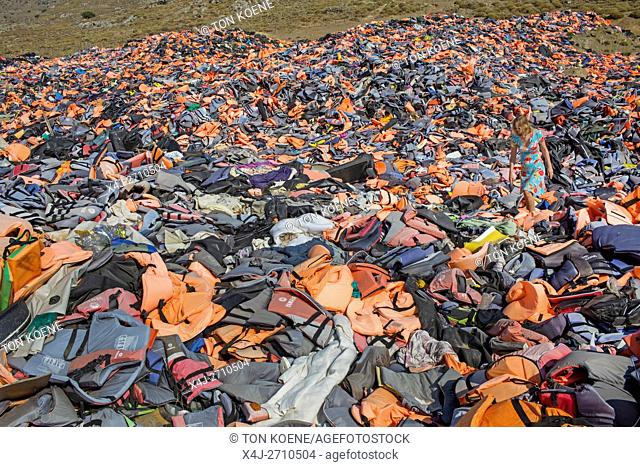 life jackets used by refugees to cross from Turkey to Greece. They are collected and dumped at the waste pit at Lesbos