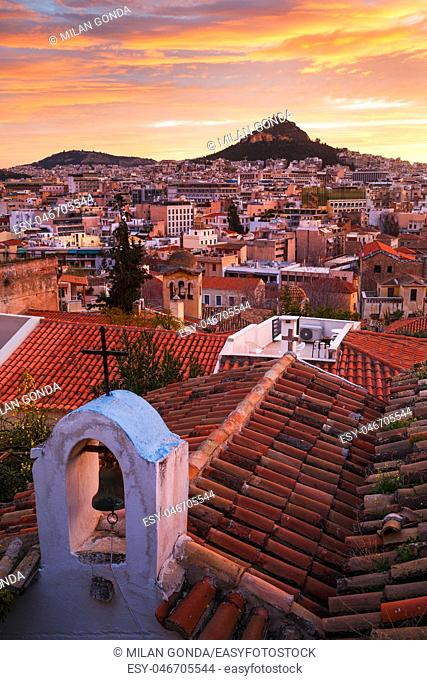 View of Lycabettus hill from Anafiotika neighborhood in the old town of Athens, Greece.