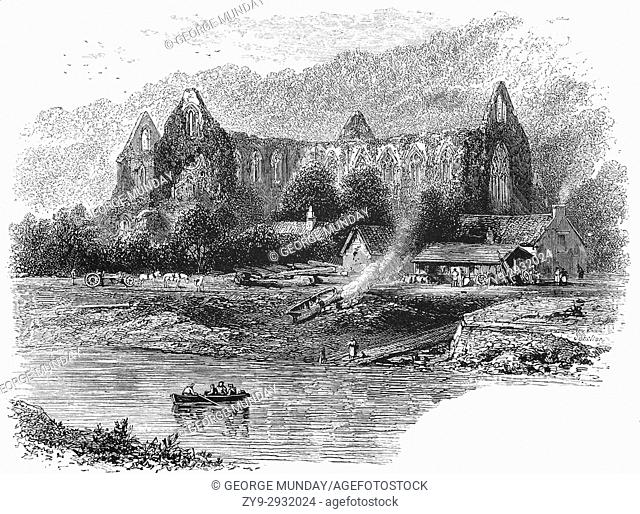 1870: Tintern Abbey, founded on 9 May 1131, viewed from the River Wye, which forms the border between Monmouthshire in Wales and Gloucestershire in England