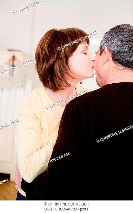 Eldery couple embracing and kissing