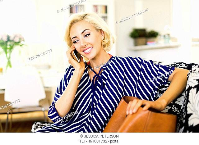 Woman using phone in living room