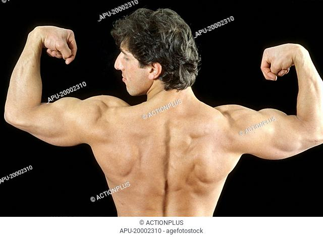 Man displaying muscle tone of upper back
