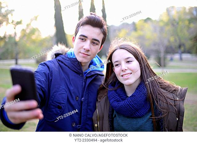 Teenagers taking a selfie in park