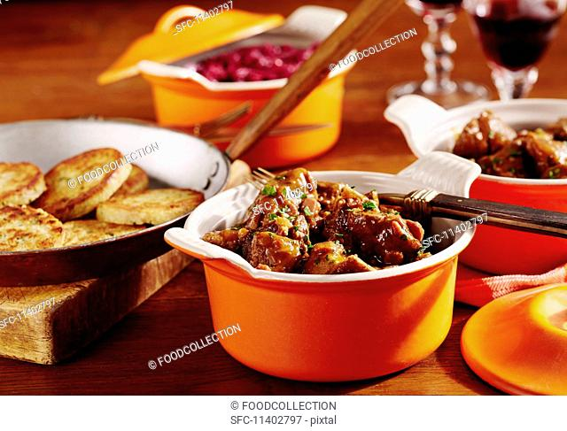 Wild boar goulash with red cabbage and napkin dumplings