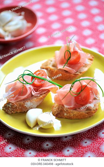 Raw ham and parmesan toasts