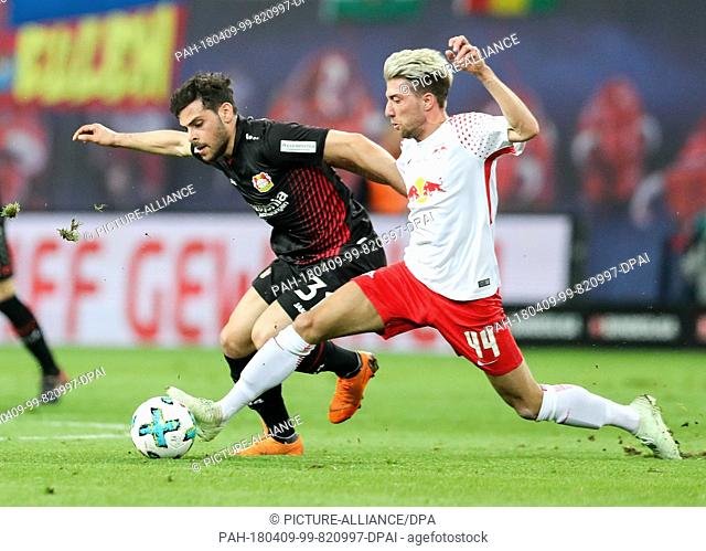 09 April 2018, Germany, Leipzig: Soccer: Bundesliga, RB Leipzig vs Bayer Leverkusen in the Red Bull Arena: Leipzig's Kevin Kampl (R) and Leverkusen's Kevin...