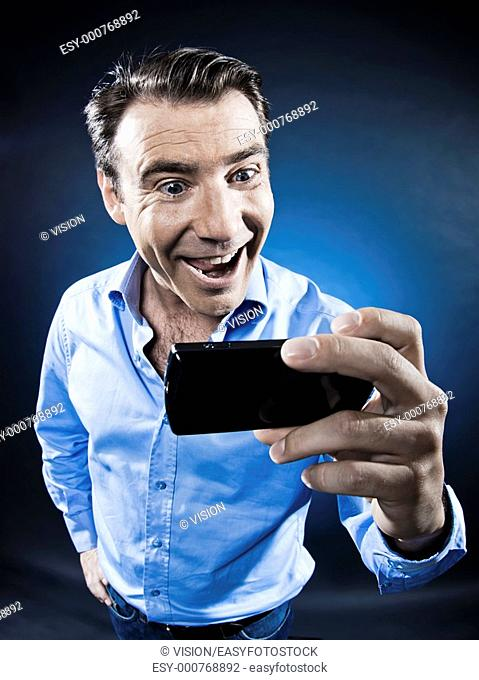caucasian man happy with cellphone portrait isolated studio on black background