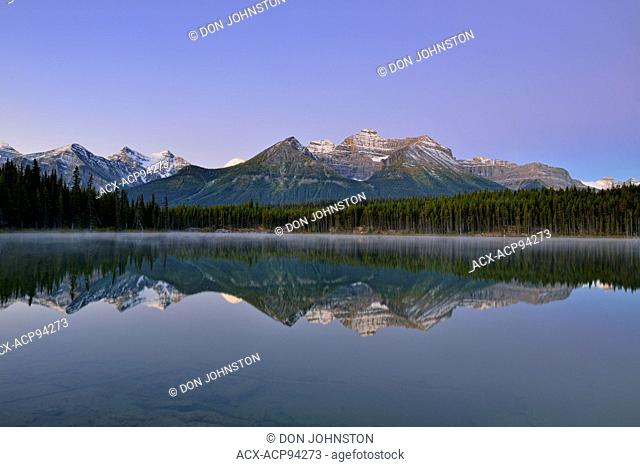 The Bow Range reflected in Herbert Lake at dawn, Banff National Park, Alberta, Canada