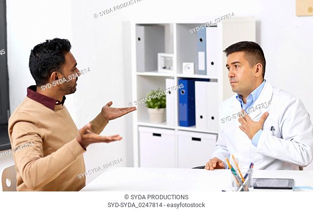 doctor and displeased male patient argue at clinic