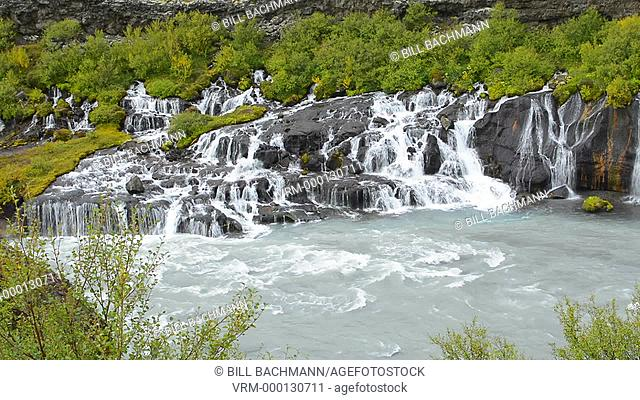 Iceland Hraunfossar Lava Falls in Reykholt Valley in West Iceland many falls along cliff from glacier Langjokull