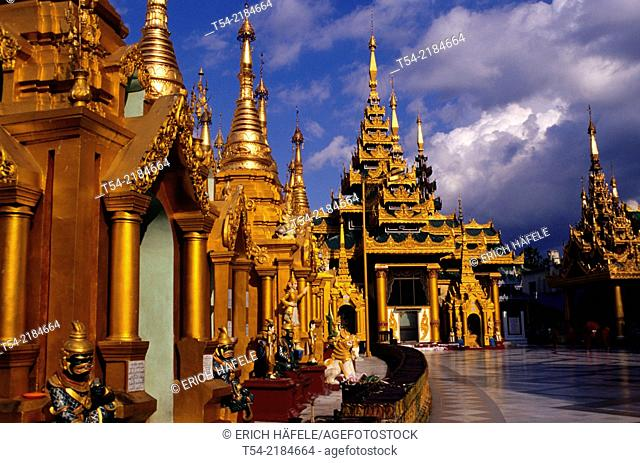 Shrines of the Shwedagon pagoda in the evening light. Yangon, Myanmar